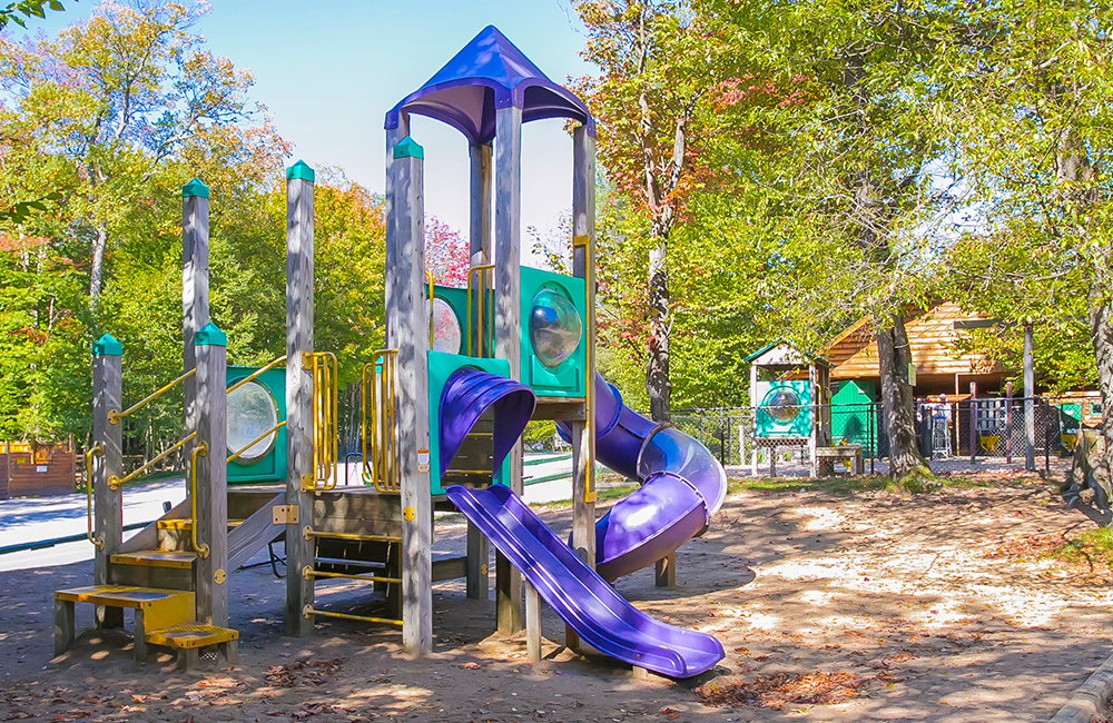 One of the playgrounds at Old Forge Camping Resort. There are slides and areas for the kids to climb.