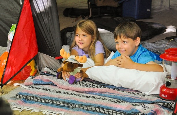 two kids in a tent holding a stuffed Walter safari