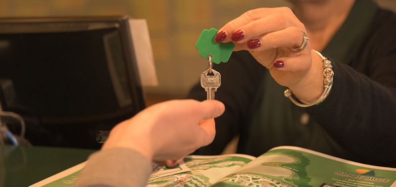 Old Forge Camping Resort staff having over a key to a guest